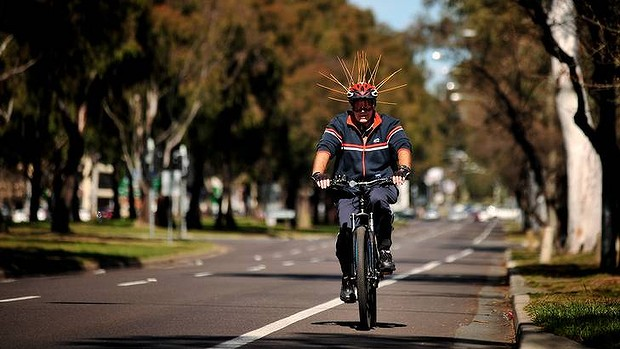 Cyclist with helmet_Canberra Times